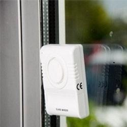 Glaskrosslarm för fönsterrutor med varningsetikett
