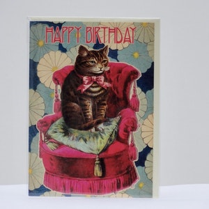 Födelsedagskort Katt i rosa fåtölj