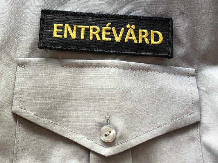 Emblem Entrévärd, broderat med eller utan kardborre