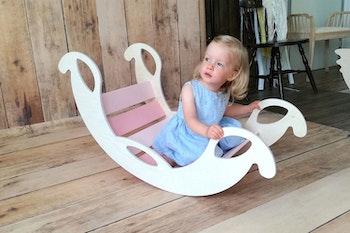 Rosa trägunga - en multifunktionell och utvecklande leksak för barn