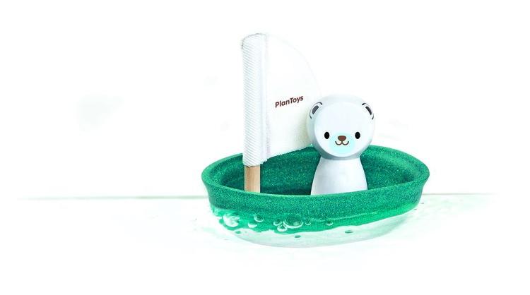 Ekologisk badleksak isbjörn i båt från Plantoys