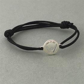 """Pick-Me-Up"" Small silver tag, black strap"