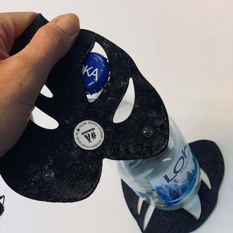 Glasunderlägg med kapsylöppnare 4-pack