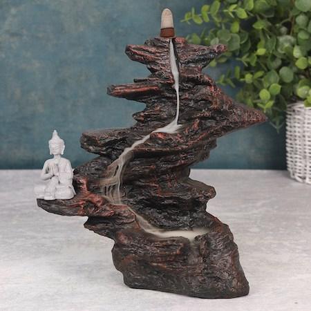 Buddha på klippa, Backflowbrännare