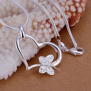 Halsband med hjärta och fjäril