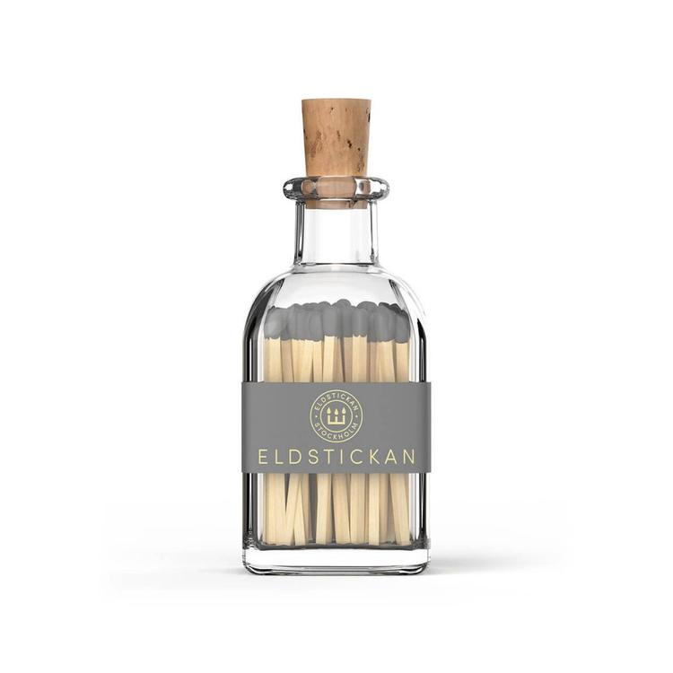 Eldstickan tändstickor flaska grå