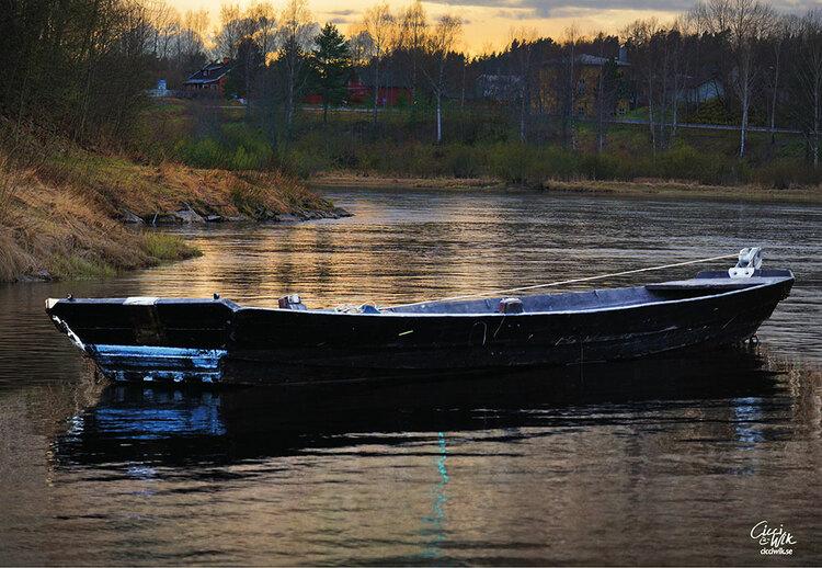 Båt i älven foto Cicci Wik
