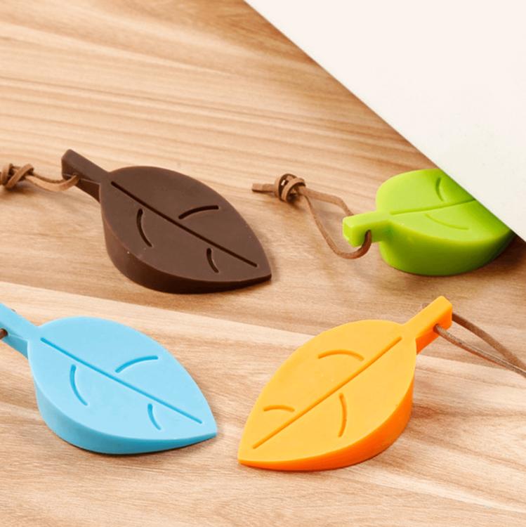 Fyra färger av dörrstopp silikon i lövformat