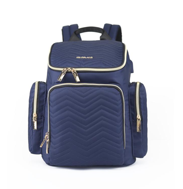 Produktbild på en marinblå skötväska från Colorland