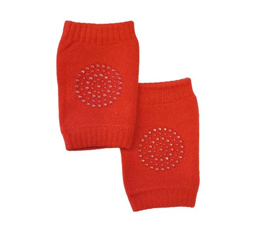 Röda krypskydd till bebis knän