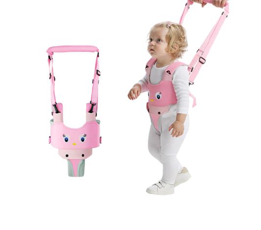 Lära gå sele med motiv av en rosa fågel, som bärs av ett barn som lär sig gå