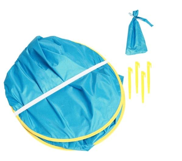 Barntält med UV-skydd i färgen blås som är ihopfällt