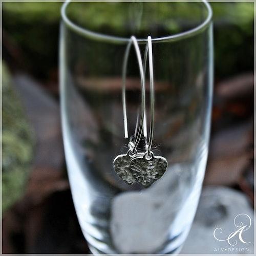 HJÄRTAN örhängen i silver