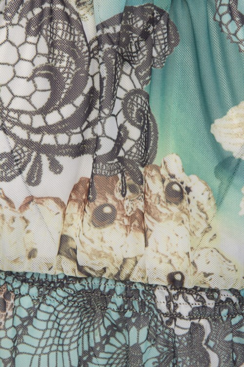 Sunkini  tunika finns i turkosmönstrat och rosamönstrat