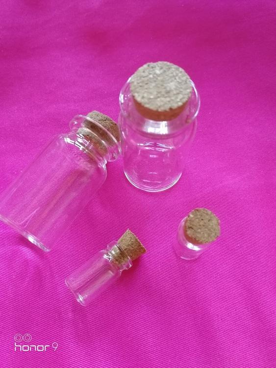 Glasflaskor med korklock