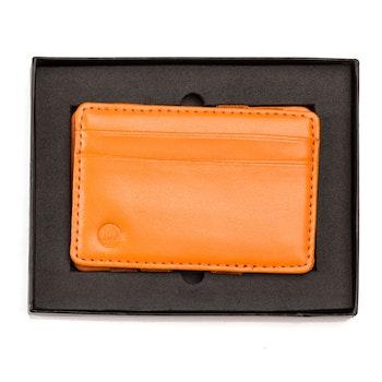Wowallet i orange läder med logga i ena hörnet i presentask sedd uppifrån