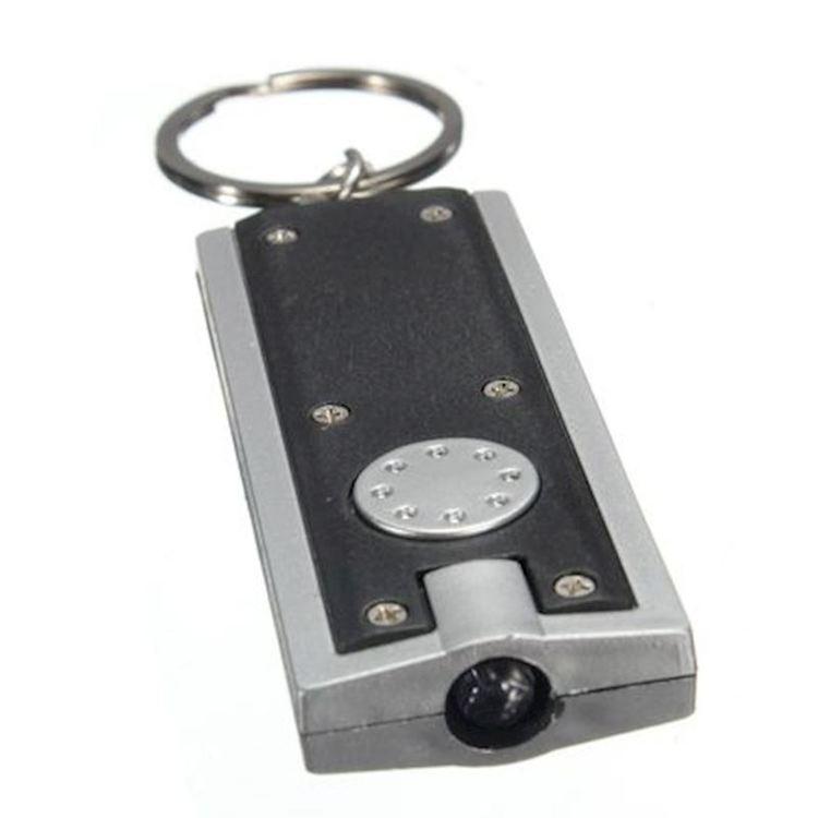 Nyckelring med Ficklampa - Material: Plast Vikt: 14 g. Storlek: 6 x 2.5 x 0.8 cm