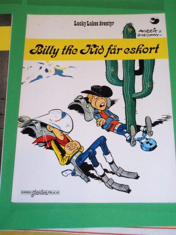"""Lucky Luke """"Billy the Kid får eskort"""", bra skick, normalslitet. Bonniers Junior Förlag"""