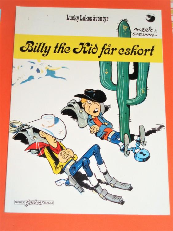 "Lucky Luke ""Billy the Kid får eskort"",bra skick, normalslitet. Bonniers junior"