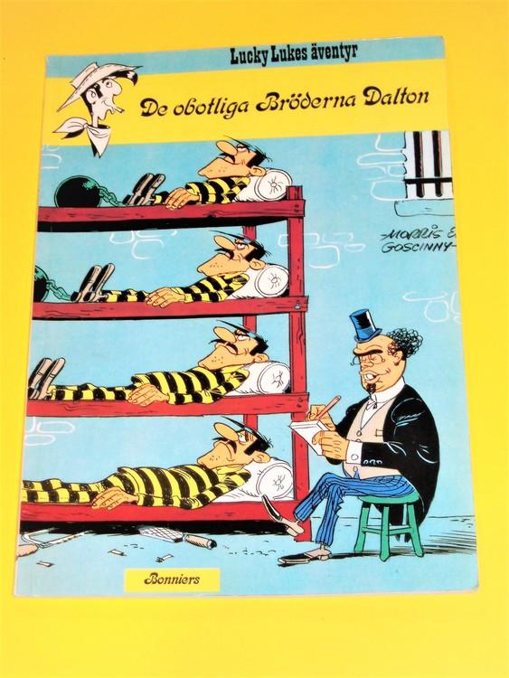 """Lucky Luke """" De obotliga Bröderna Dalton """", välläst, normalslitet. Bonniers"""