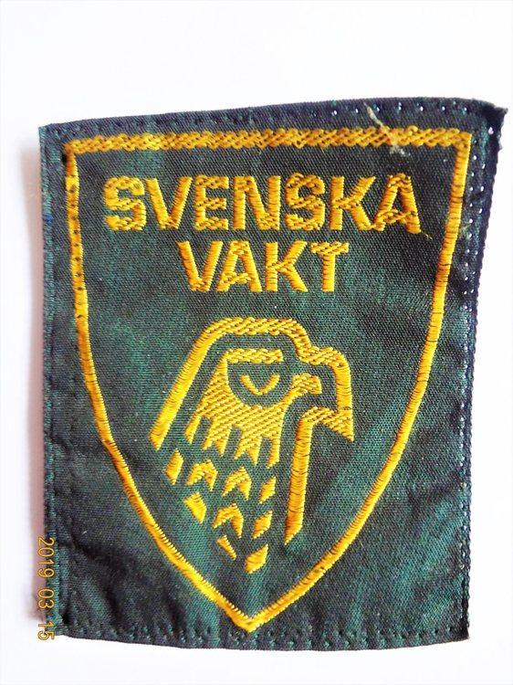 Svenska Vakt Tygmärke -70 tal 6.2 x7.8 cm.Dotterbolag till ABAB Mycket bra skick.