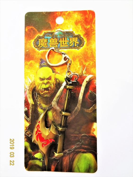 World of Warcraft Nyckelring i Metall Längd 8.5 cm Mycket bra skick.