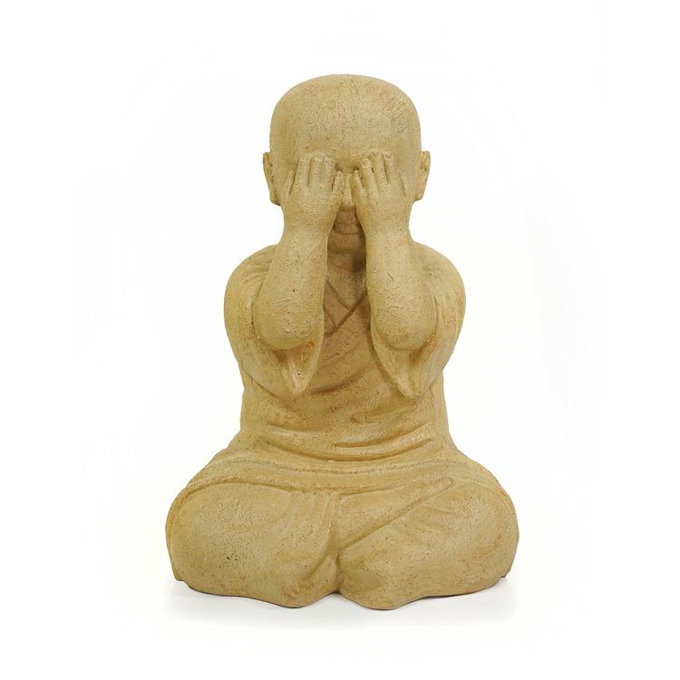 Skulptur av munk som håller för ögonen