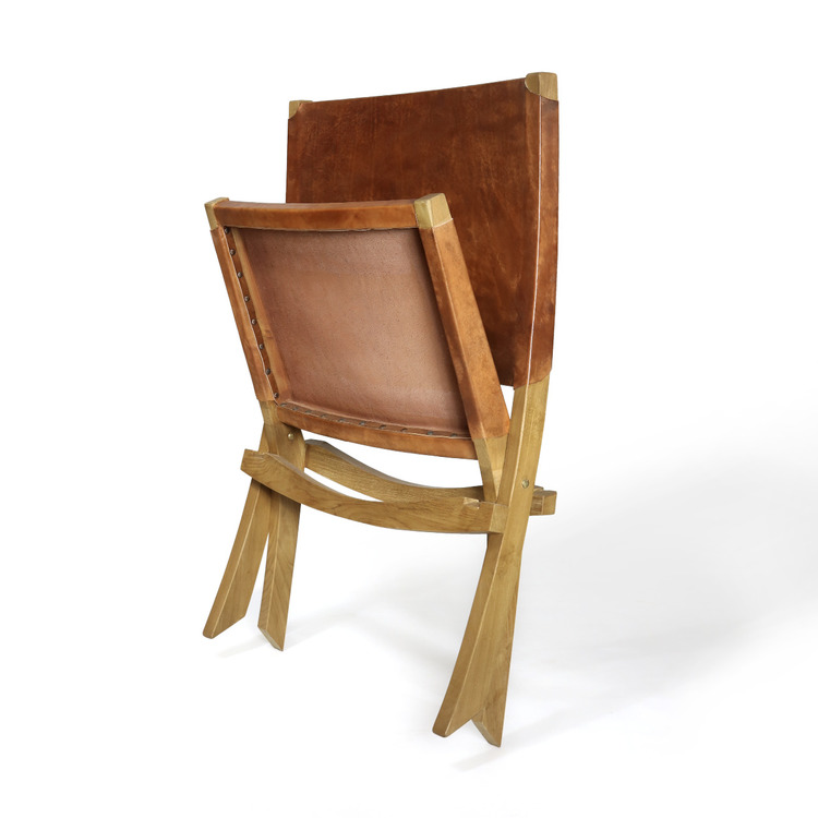 Ihopfälld loungestol av teak och läder