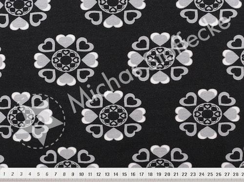 Öko-tex Stretchjersey hjärtblommor svart 0,6m