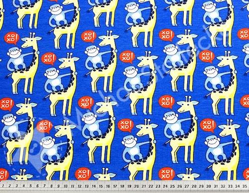 Ekologisk Stretchjersey giraff på blått 1m
