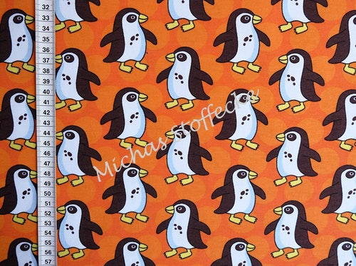 Ekologisk Stretchjersey Pingviner brun på orange 1m