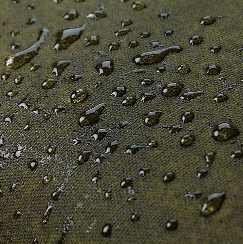 Olivgrön vaxad messengerbag
