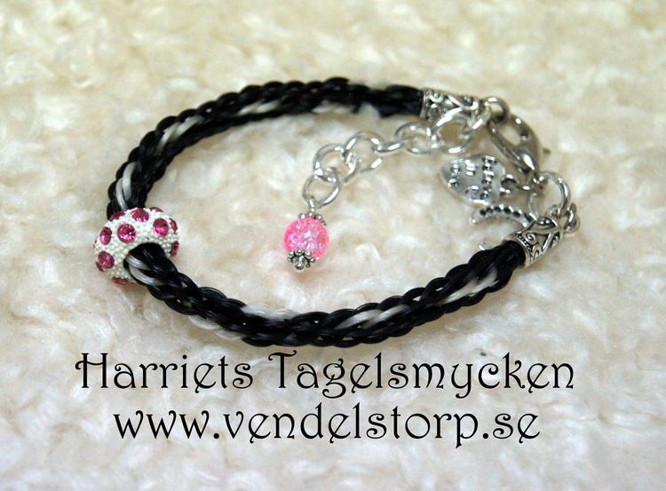 Rondell, vit med rosa små stenar