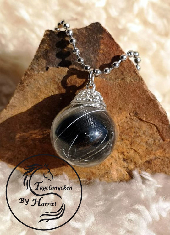Halsband, glasbubbla, silver/guldfäste och tagel