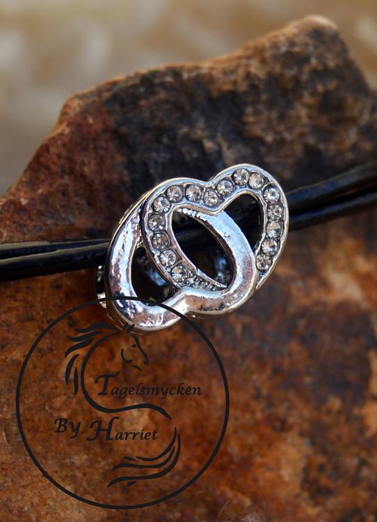 Rondell, dubbelhjärta med små stenar