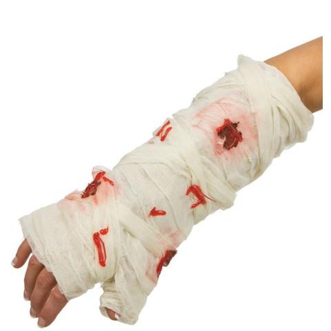 Blodigt bandage med glasskärvor