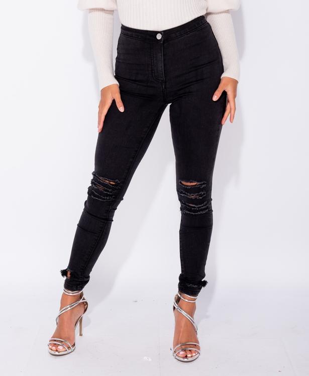 Ripped kolsvarta jeansjeggings