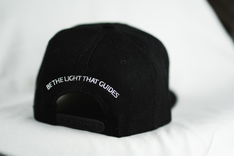 "Snapback - ""Be the light that guides"""
