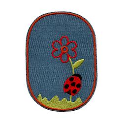 Laglapp - Nyckelpiga på blomma