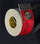 Måttband med knapp