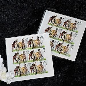 Hästar på glasunderlägg