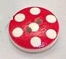 Rund träknapp röd bakgrund vita prickar två hål