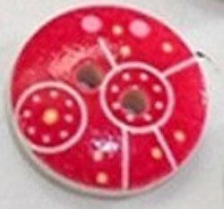 Rund träknapp röd bakgrund och cirklar ovanpå två hål