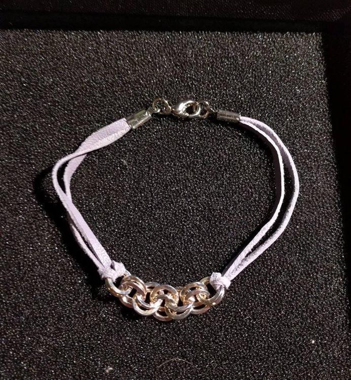 Läderarmband med silverringar 18 cm