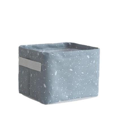 Liten grå förvaringskorg