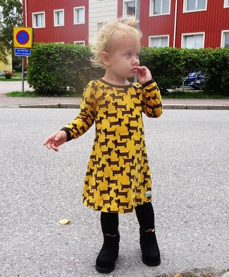 Klänning med lång ärm - exempelbild