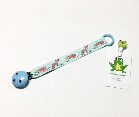 Napphållare med tecknade rävar - Träclips Ljusblå och silikonring Babyblå