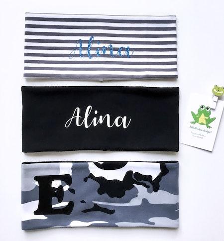 Pannband med blå glittervinyl och vit vinyl, stil nr 1 samt bokstavspannband, bokstav i svart