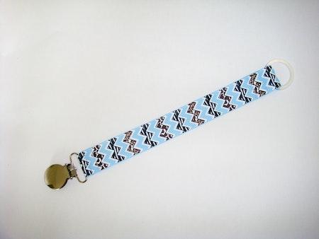 Napphållare med zigzagmönstrat band Chevron Wild Ljusblå