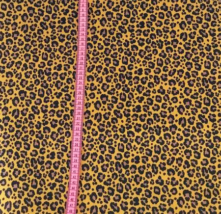 Tygbild, tyg till mössa - Leopard Senap, ökotexmärkt trikå